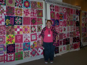 Proud Valerie in front of the blocks that will be made into Opportunity Quilts for next year's QuiltFest.